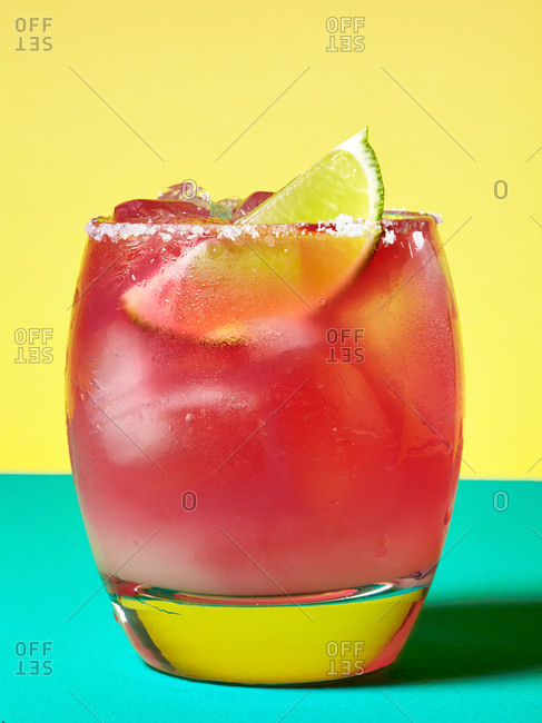 Pink cocktail with lime garnish