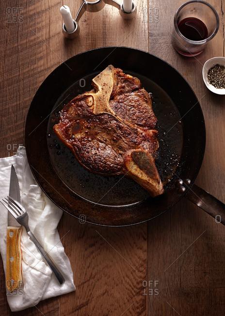 T-bone steak in skillet