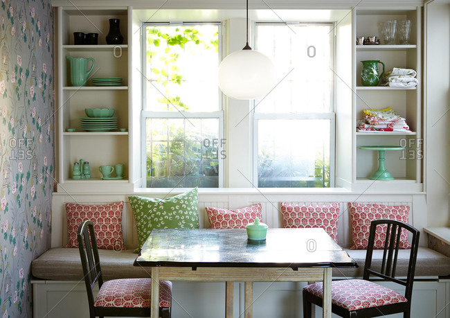 Breakfast nook with red and green accents