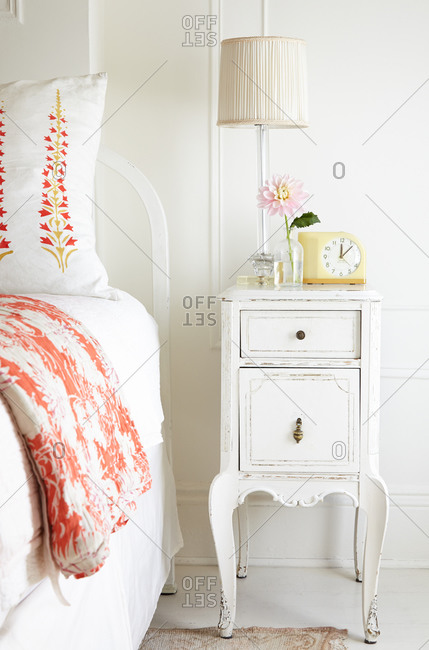 Distressed nightstand in a master bedroom