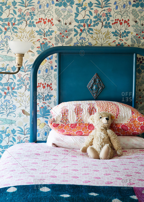 Girl's bed with teddy bear