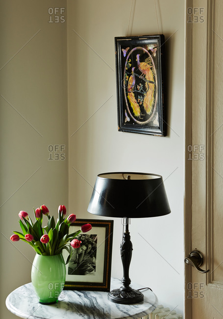 Vignette in living room with fresh tulips