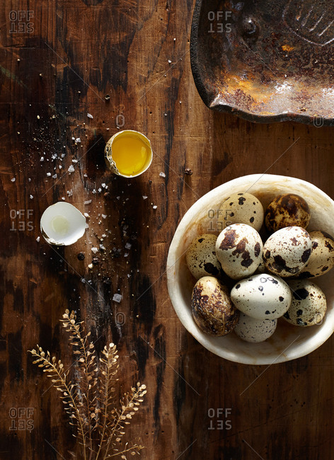 Quail eggs with one cracked open