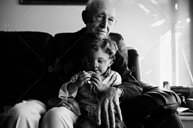 Child in grandfather's lap