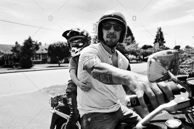 Boy and man on motorcycle