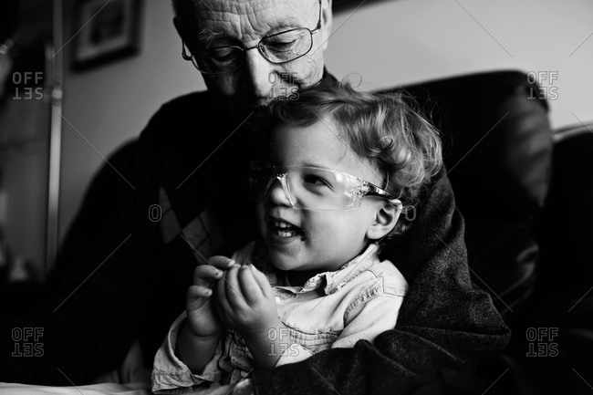 Granddad and boy in safety glasses