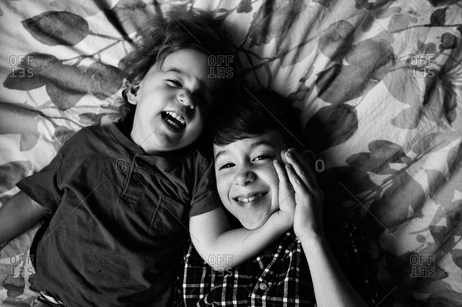 Boys goofing around on bed