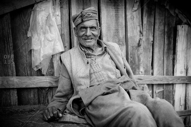 Dharamsala, India - March 22, 2015: Black and white portrait of a senior Indian man