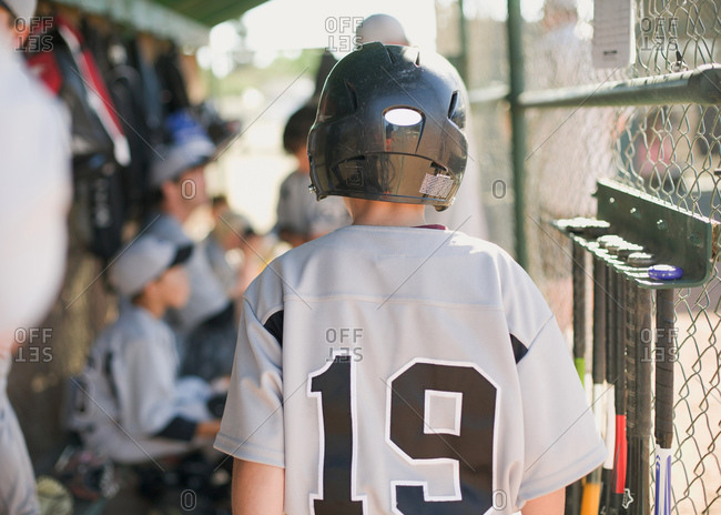 Rear view of a boy in a baseball uniform