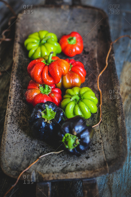 Bell peppers in a wooden tray