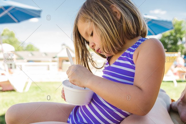 Girl eating alone while sitting outside