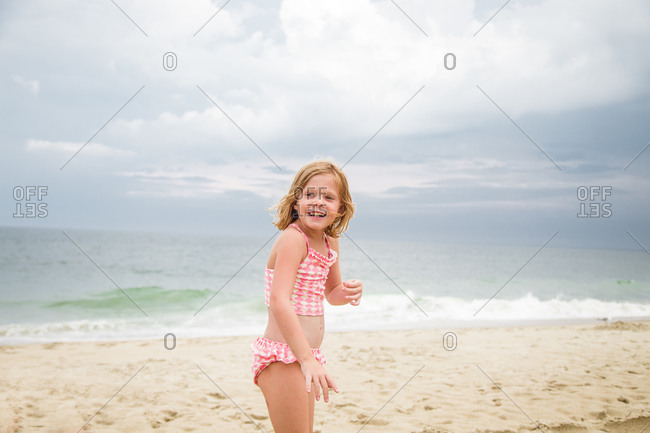 Laughing girl at the beach