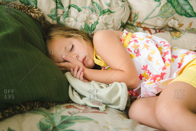 Girl taking a nap on sofa