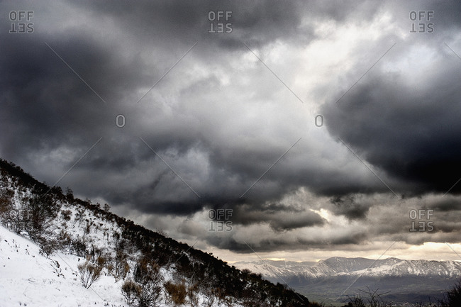 Snow covered mountains against dramatic sky, Polla, Campania, Italy