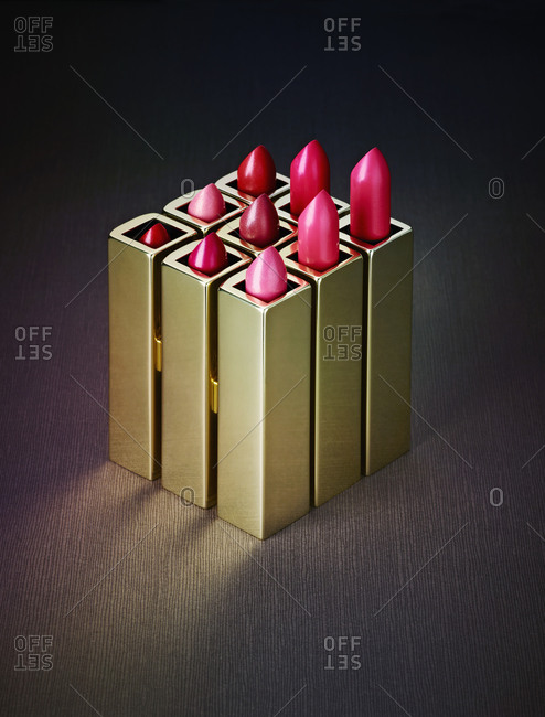 Close-up of various pink lipsticks on table