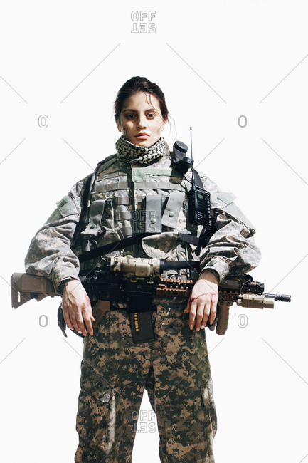 Portrait of army soldier standing with rifle against white background
