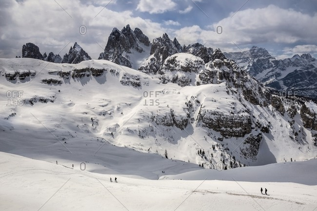 Hikers in snow in Italian mountains