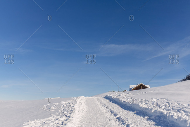 Path through snow on hill