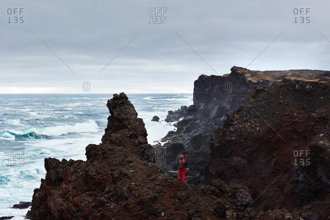 Man hiking over rocks
