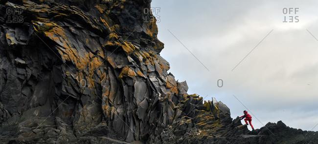 Man hiking along coastline in Iceland