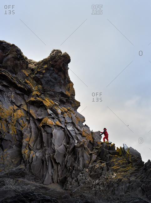 Man hiking along coastline
