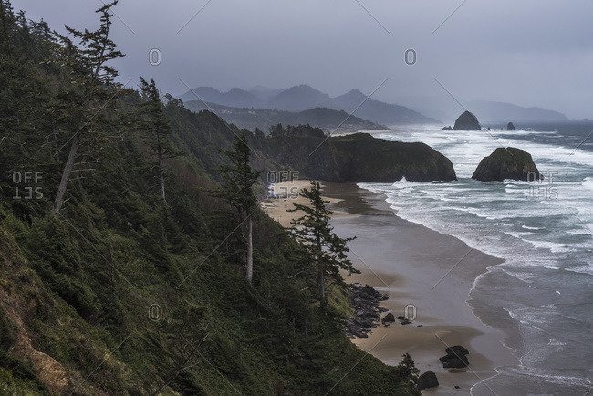Rain creates a somber mood on the Oregon Coast; Cannon Beach, Oregon, United States of America