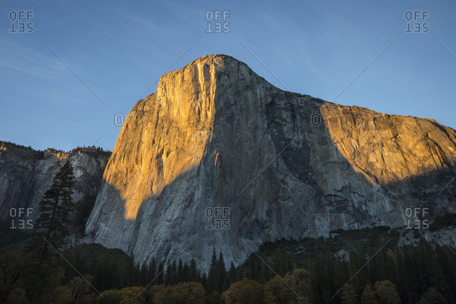 El Capitan (El Cap) bathed in late afternoon fall light in Yosemite Valley, Yosemite National Park; California, United States of America