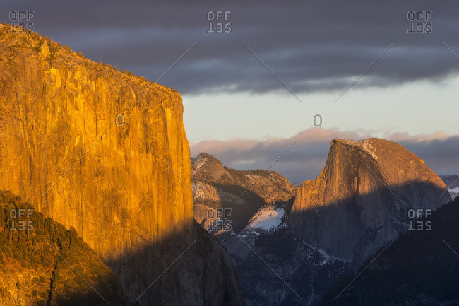 El Capitan and Half Dome in late afternoon winter light, as seen from Turtleback Dome in Yosemite National Park; California, United States of America