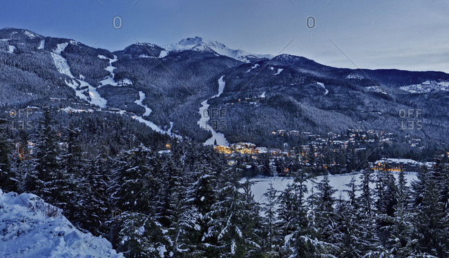 Dusk settles on Whistler Mountain in the creekside of Whistler; Whistler, British Columbia, Canada