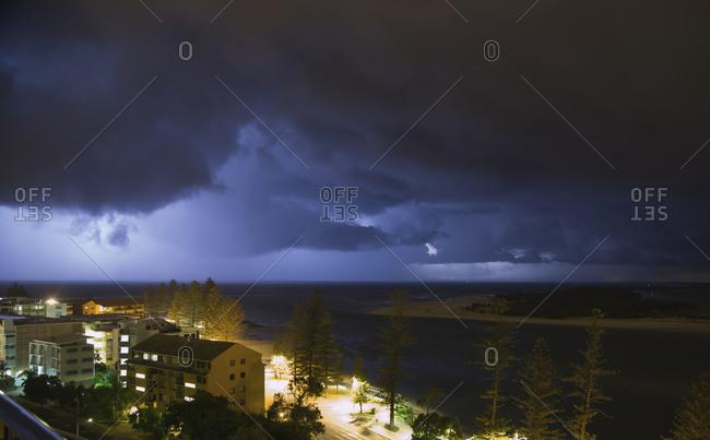 Storm clouds over a city; Caloundra, Queensland, Australia