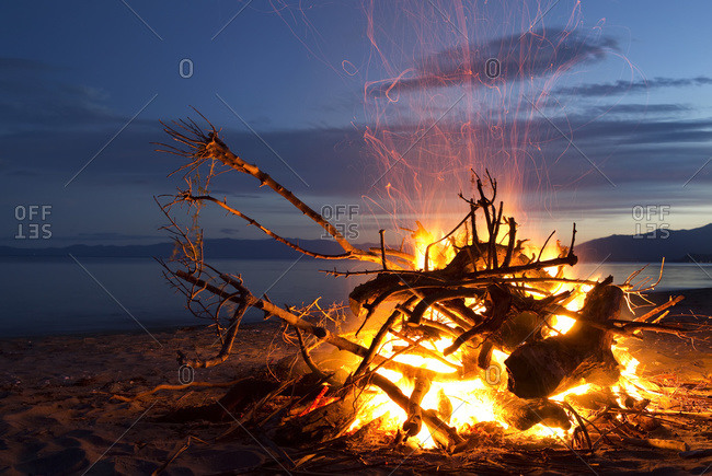 Bonfire on the beach at Golden Bay, New Years Eve; South Island, New Zealand
