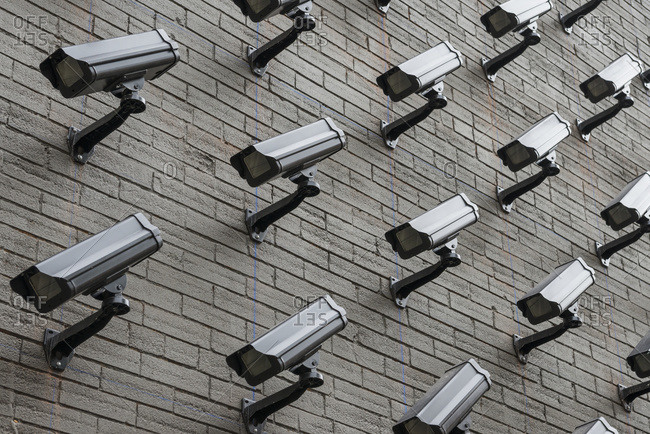 The wall of a building fully covered by monitoring cameras; Toronto, Ontario, Canada