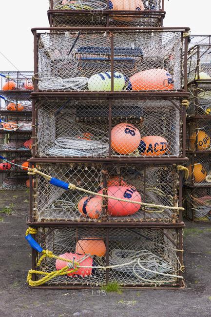 Crab pots and bouys stacked on shore, St. Paul Harbor, St. Paul Island, Southwestern Alaska, USA
