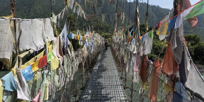 Colourful prayer flags lining a walkway; Thimphu, Bhutan