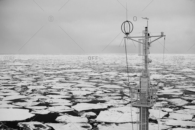 Mast Of A Ship In The Sea Filled With Floating Ice; Spitsbergen, Svalbard, Norway