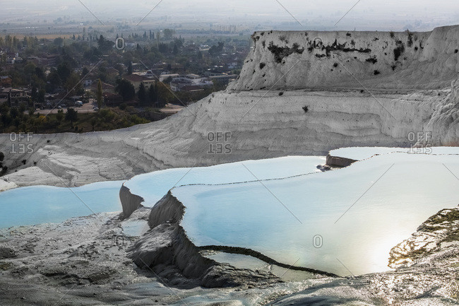 Hot springs and travertines, terraces of carbonate minerals left by the flowing water; Pamukkale, Turkey