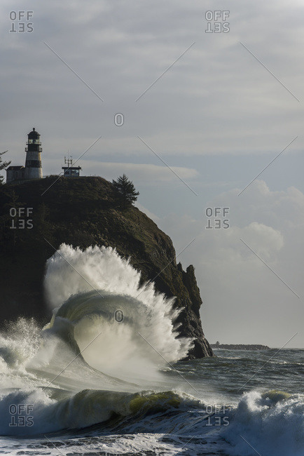 Surf breaks at Cape Disappointment Lighthouse; Ilwaco, Washington, United States of America