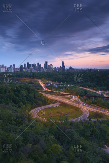 Sunset looking south over the Don Valley, Bloor on-ramp, Toronto skyline and Don Valley Parkway; Toronto, Ontario, Canada