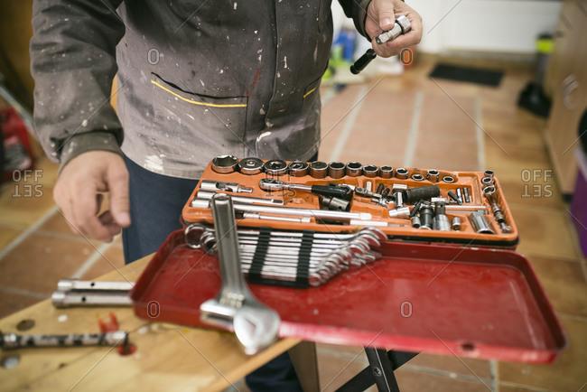 Senior man with an open tool box