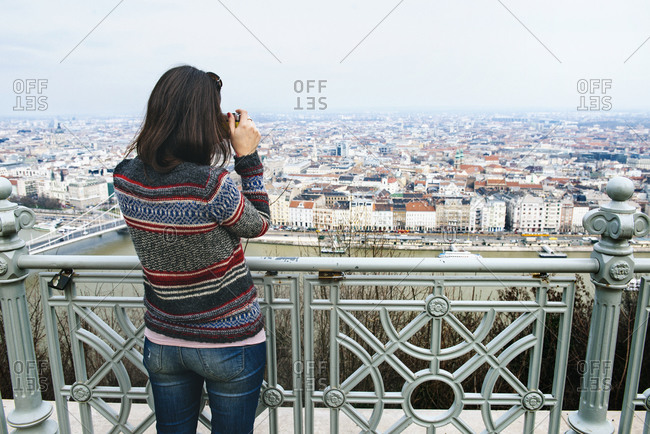 Woman taking a picture from Gellert Hill
