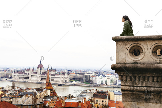 Woman looking on the Parliament Building from Castle Hill
