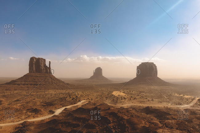 Three peaks of Monument Valley during a summer day