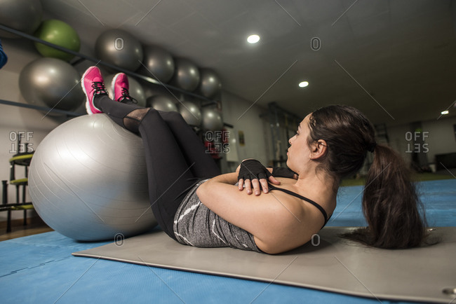 Woman abs training with fitness ball