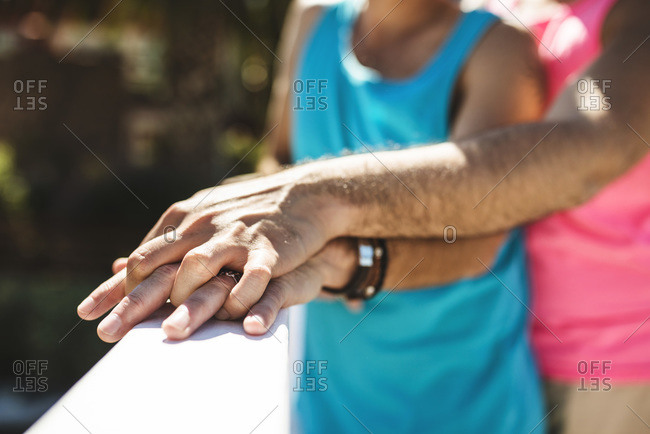 Clasped hands of gay couple
