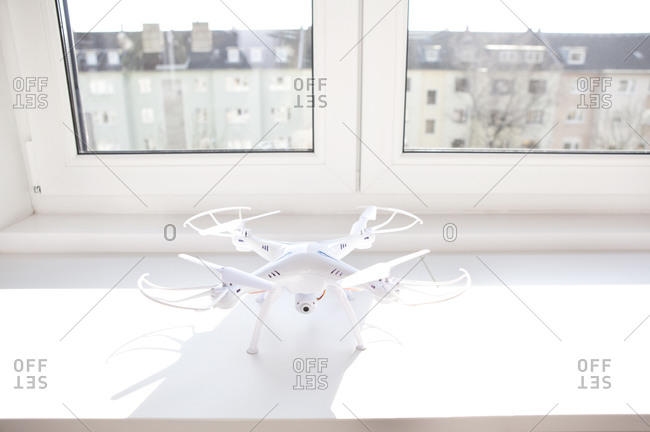 White drone on a window sill