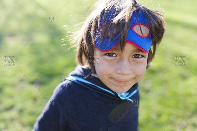 Portrait of little boy dressed up as superhero