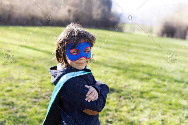 Confident little boy dressed up as superhero