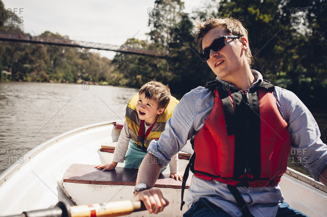 Father and son riding in a row boat