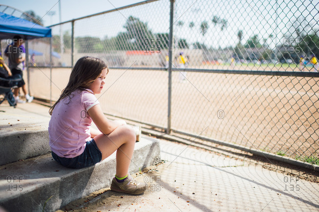 Girl watching a baseball game
