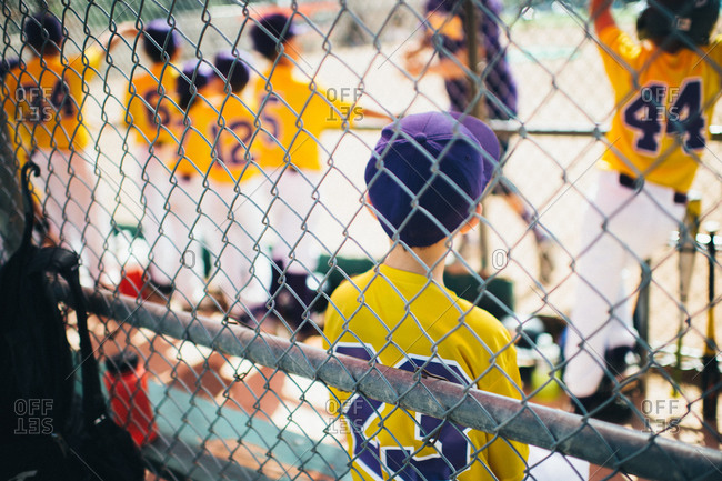 Boys on a baseball team in a dugout
